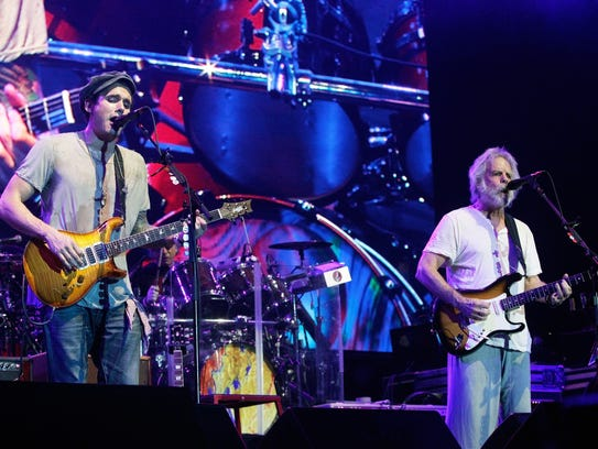 John Mayer, left, performs with Bob Weir of Dead &