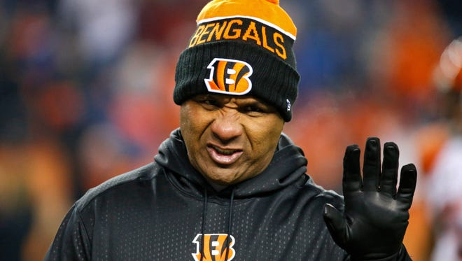 Bengals offensive coordinator Hue Jackson waves to referees as they take the field during warmups before kickoff of the NFL Week 16 game between the Denver Broncos and the Cincinnati Bengals at Sports Authority Field at Mile High in Denver on Monday, Dec. 28, 2015.