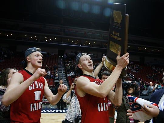 Cedar Falls' AJ Green (4) holds the trophy as Cedar