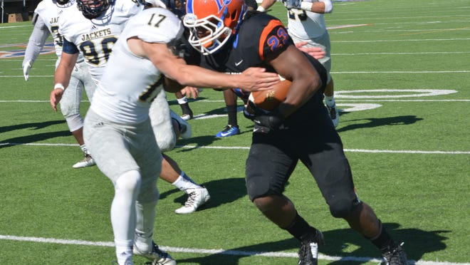 Louisiana College freshman tailback Devin Sylve (23, right) gets past Howard Payne defender Gage Smith Saturday in the Wildcats' 55-28 victory over Howard Payne at Wildcat Field.