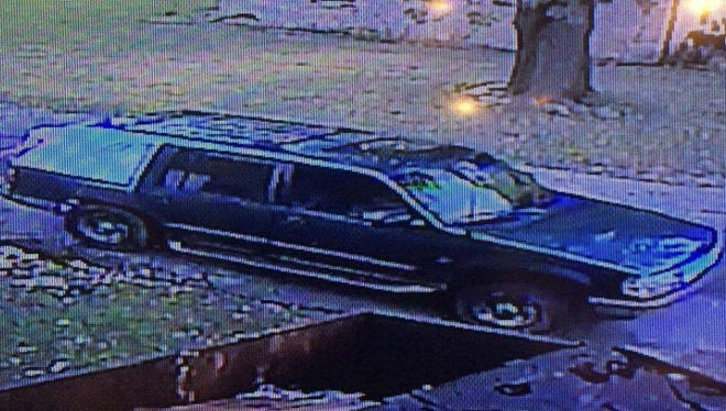 Greenfield police believe the man who robbed the Old National Bank got away in a green Ford Explorer with plastic covering a damaged rear window.