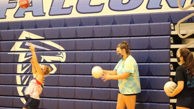 Frankfort volleyball players socially distanced and masked for practice. Tribune photo by Chapin Jewell