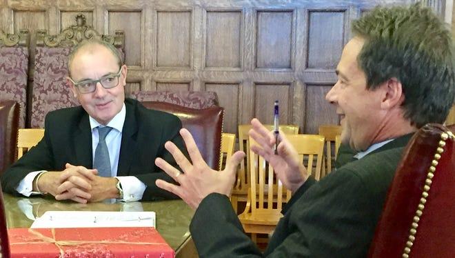 Gov. Steve Bullock, right, talks Friday with David O'Sullivan, European Union ambassador to the United States.