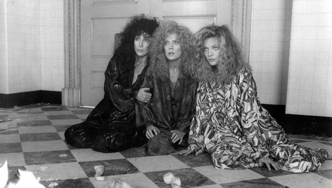 """Cher (from left), Susan Sarandon and Michelle Pfeiffer star in """"The Witches of Eastwick."""" The hair tells you the movie came out in 1987."""