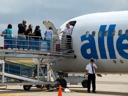 Passengers board the Allegiant Air flight to Orlando,