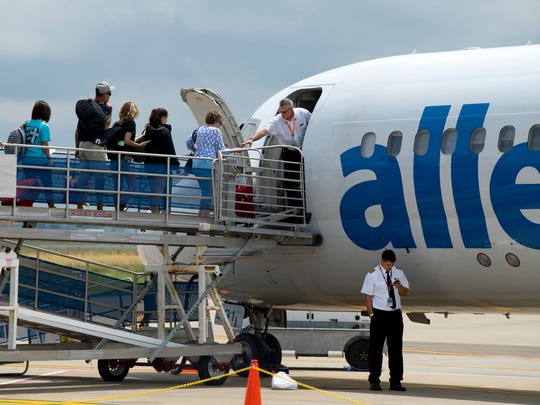 Passengers board the Allegiant Air flight to Orlando, Fla., at the Owensboro-Daviess County Regional Airport Friday afternoon.