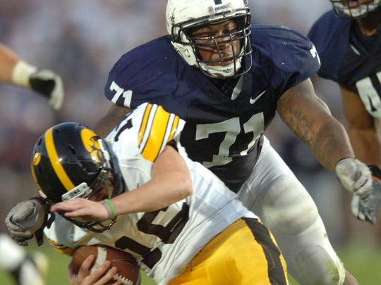 Devon Still stops Iowa quarterback James Vandenberg during a 2011 game at Beaver Stadium.