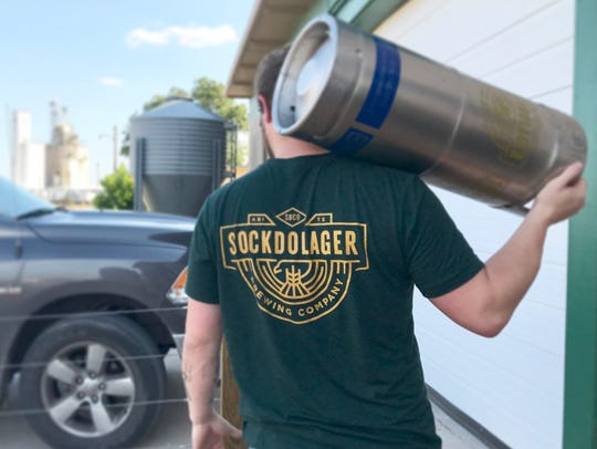 Will Meiron, part owner of Sockdolager Brewing Co., with a keg. Sockdaloger's has plans to relocate to the downtown area.