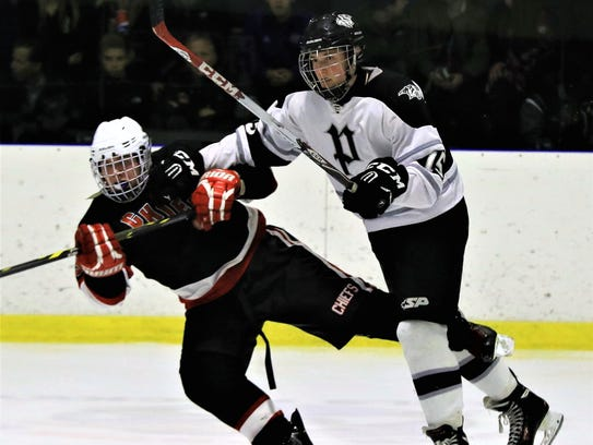 C.J. Mullenax (right) of the Plymouth Wildcats is shown