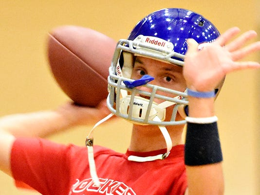 Spring Grove quarterback Jake Messersmith throws the ball during football practice in the gymnasium at the school in Spring Grove, Pa. on Wednesday, Oct. 28, 2015. Dawn J. Sagert - dsagert@yorkdispatch.com