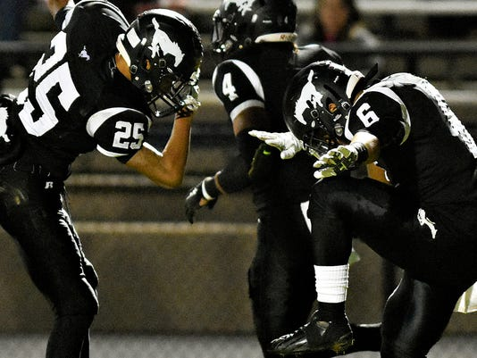 South Western's Jeff Green, left, and Teian Moore, right, celebrate a touchdown during high school football action against Northeastern at South Western in Hanover, Pa. on Friday, Oct. 30, 2015. South Western would win the game 24-7. Dawn J. Sagert - dsagert@yorkdispatch.com