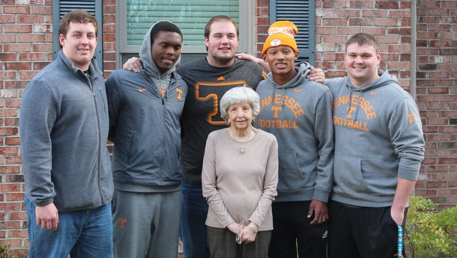 Bonnie Palmer, the 94-year-old great aunt of Tennessee offensive lineman Brett Kendrick, poses with Tennessee football players last Thanksgiving. The Kendrick family has hosted players for Thanksgiving  in Knoxville since 2013 and Palmer makes it a tradition to get a photo each year to put on her mantle.
