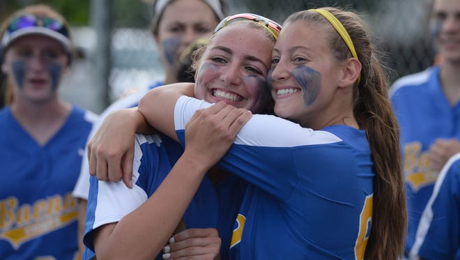 Buena's Nat Ampole, left and Sammie Maxwell smiles as they pose for a picture with the South Jersey Group 1 softball championship trophy after defeating Audubon 3-0 on Wednesday. 05.32.17. Joe Warner/For the Courier-Post