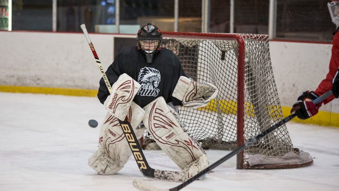 Port Huron goalie Ally Fetterly blocks a shot on goal during a practice at McMorran Arena in Port Huron.