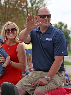 Fishers' first mayor Scott Fadness is the parade grand marshall with his family Lincoln Fadness and Aunna Fadness at the Fishers Freedom Festival Parade, Sunday, June 28, 2015.