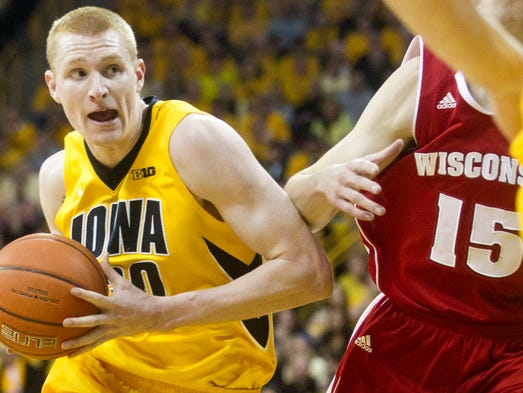 Iowa's Aaron White drives the lane during the Hawkeyes game against Wisconsin at Carver-Hawkeye Arena in Iowa City on Saturday, February 22, 2014. Benjamin Roberts / Iowa City Press-Citizen