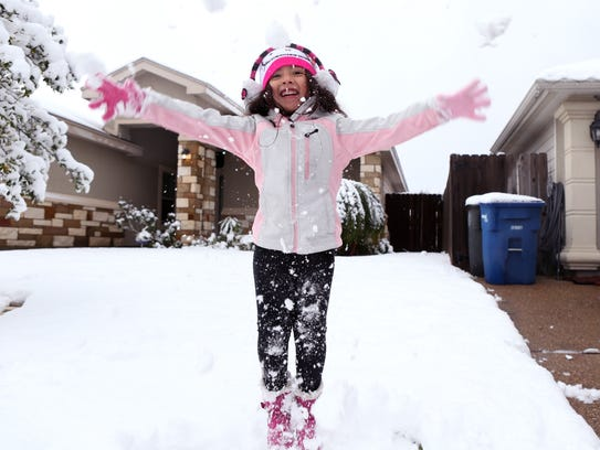 Jessy De La Garza, 5, jumps with joy at her home on