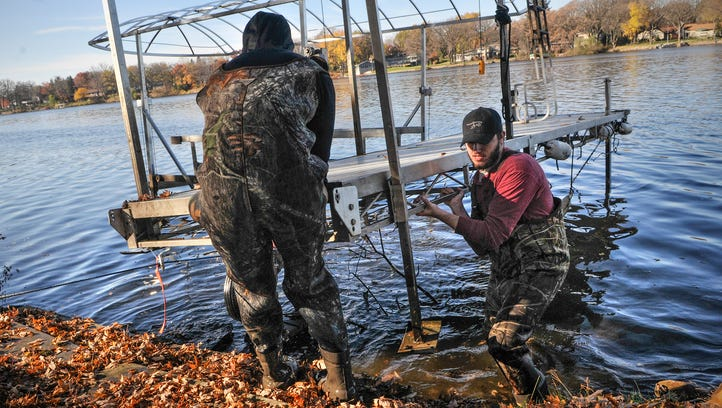 Signs of fall: Dock removal on the Mississippi River