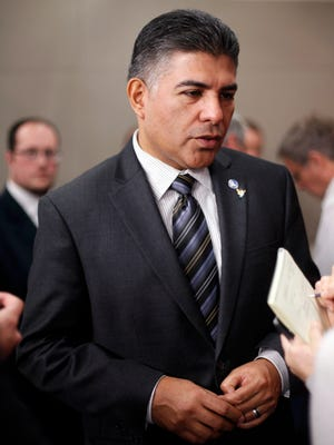 In this Nov. 13, 2012 file photo, newly-elected Rep. Tony Cardenas, D-Calif., is interviewed following a news conference with newly elected Democratic House members, on Capitol Hill.