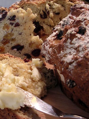 Warm Irish Soda Bread can be served with honey butter. The bread has a wonderful aroma and makes a tasty snack.