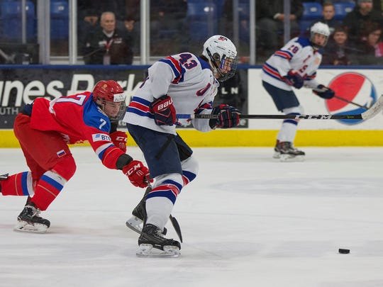 Jack Hughes (43) of the U.S. Under-18 team tries to