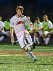 Ankeny's Will Nurre (10) moves the ball back up field on Thursday.