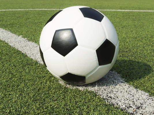 636084245529618901-soccerball-turf.jpg