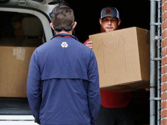 Boston Red Sox relief pitcher Craig Kimbrel packs his belongings Wednesday, Oct. 11, 2017, at Fenway Park in Boston. The Red Sox fired manager John Farrell on Wednesday after the team's second straight loss in the AL Division Series. (AP Photo/Bill Sikes)