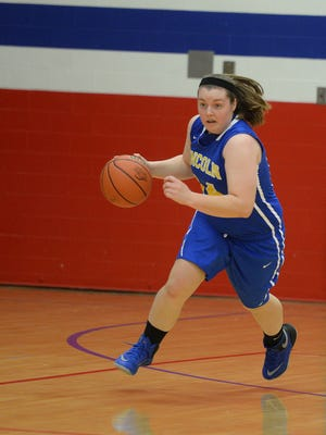 Lincoln's Kerrigan Neff moves the ball against Winchester during the class 2A girls basketball sectional 41 championship game Saturday, Feb. 6, 2016, at Union County High School in Liberty.