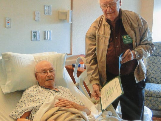 Lebanon Quittapahilla Forest No. 25 member John Jackson is all smiles as he receives his 50-year award from Marlin Shenk, Senior Grand Tall Cedar. Jackson was in the hospital because of a slight stroke, according to Shenk.