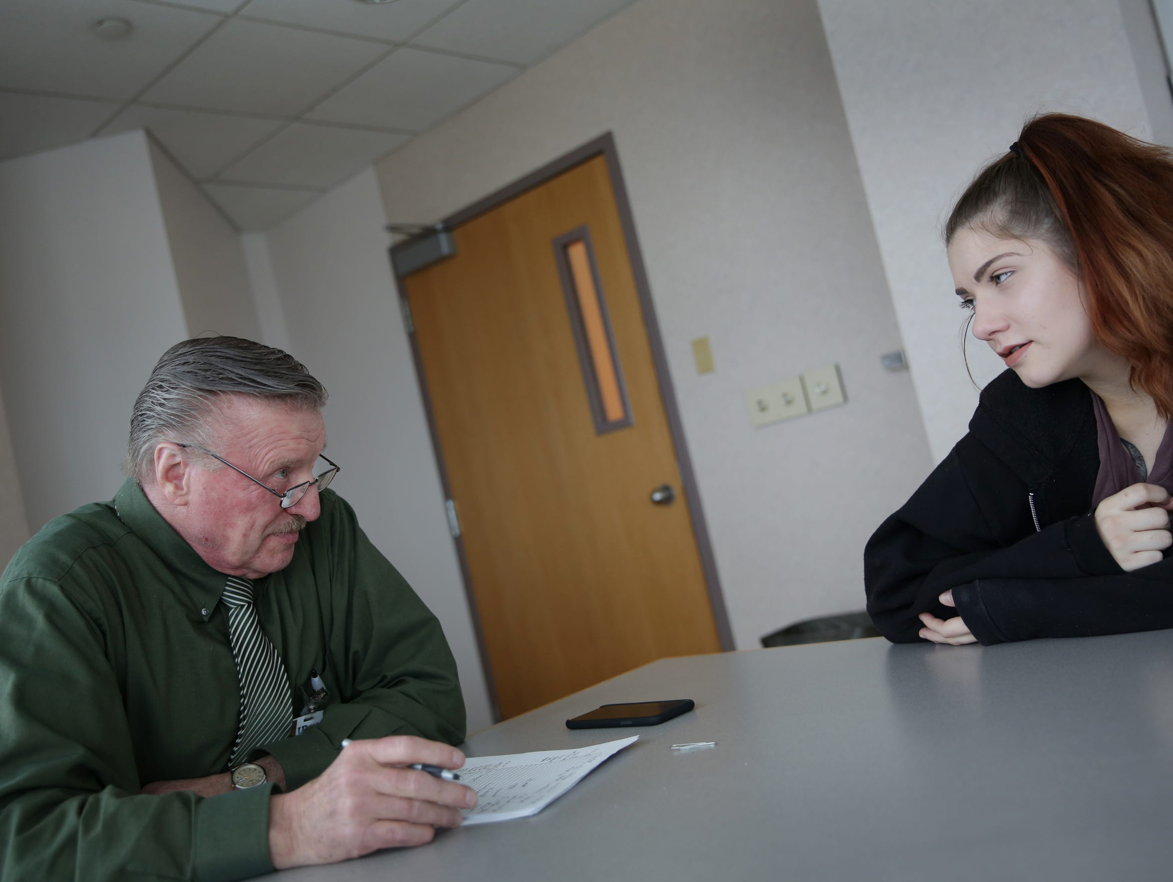 Chelsea Reichel meets with addiction medicine Dr. John Lehtinen at UP Health System in Marquette, Mich. on March 9, 2018.