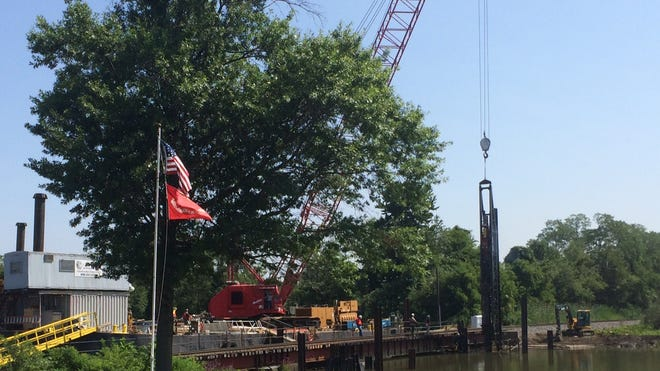 Conrail is driving pilings for the new Jefferson Street bridge, the site of the Paulsboro derailment, to open in 2015.