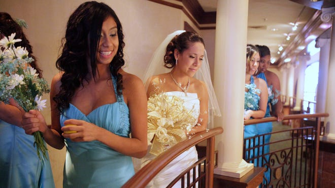 Bride Paulita Flores looks down off the balcony as she prepares for her wedding in Indianapolis on  Dec. 4, 2010.