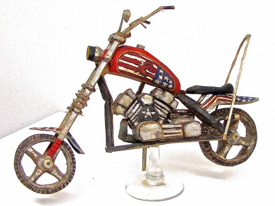 """""""Chopper,"""" wood assemblage by Terry VanVorous, part of the new exhibit at Meadows Art Gallery in Sister Bay."""