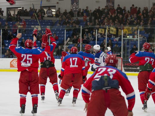 Players from Team Russia's Under-17 team celebrate after defeating Team USA 5-3 Saturday night in Plymouth.