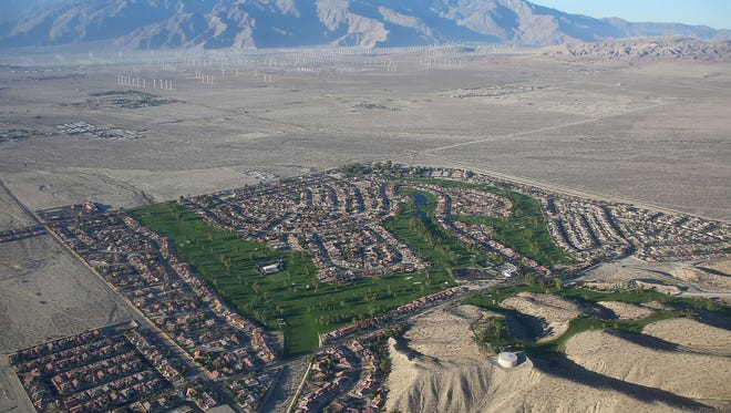 Rows of homes and Mission Lakes Country Club in Desert Hot Springs are surrounded by open desert in this 2014 photograph.