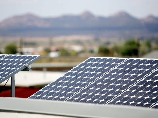 Solar panels line a roof at a storage facility in Cedar City.