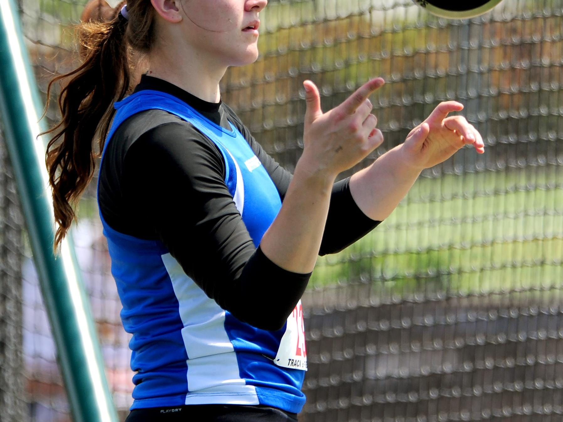 Amity's Lindsay McShane prepares to throws the discus during the OSAA Class 3A Track & Field Championships inside Hayward Field at the University of Oregon, on Thursday, May 21, 2015, in Eugene.