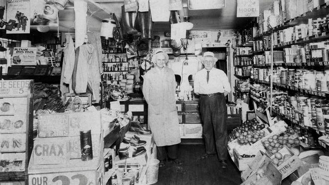 Old Brick Store owner Roy Williams( left) with Fred Whitcomb in a photo from the general store days.