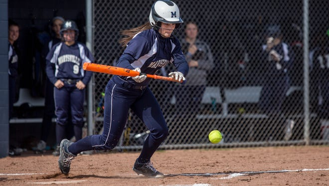 Marysville's Samantha Smith bunts the ball during a softball game at Marysville High School.