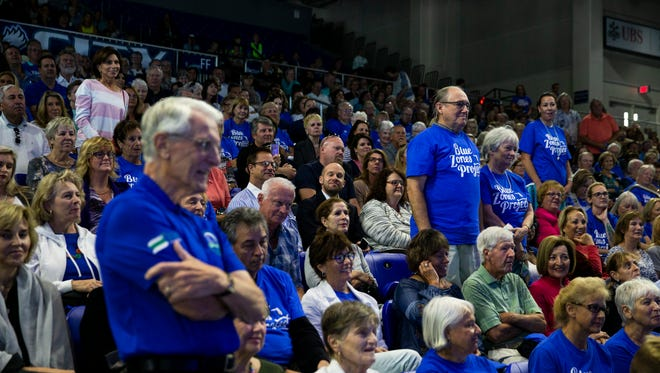 Members of the audience stand after a series of questions from Dan Buettner classified them as the happiest people during his presentation at FGCU's Alico Arena in Fort Myers on Monday, April 16, 2018. Buettner, also a National Geographic Fellow, discovered the five places in the world — dubbed Blue Zones — where people live the longest, healthiest lives.