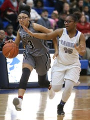 Sussex Tech's Airelle Parker (left) was named to the All-Henlopen North first team in girls basketball.