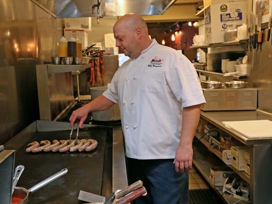 "Billy Rawstrom, owner of Maiale Deli and Salumeria, put some  sausage on the grill at his deli in the Cannery Shopping Center. The popular shop has been featured on the Food Network series ""Diners, Drive-ins and Dives."""
