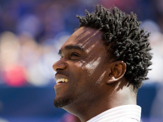 Edgerrin James, former Colts running back, smiles as he watches video highlights of his career, before being inducted into the Ring of Honor for the Indianapolis Colts, Lucas Oil Stadium, Sept. 23, 2012.