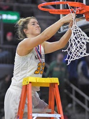 Aberdeen Central's Paiton Burckhard cuts down the net