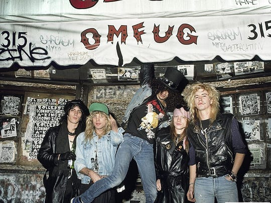 Guns N' Roses outside CBGB, the legendary New York punk club, in 1987. The photo, by Mark Weiss, is among those that were recently made available for auction at rocksceneauctions.com. A print is now being raffled off on the site.