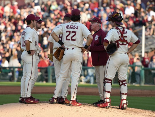 FSU head coach Mike Martin talking to pitcher Andrew