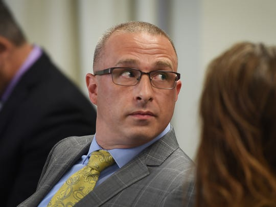 Former member of the Hackensack Police Department Sgt Justin de la Bruyere is seen in court as former Hackensack Officer Victor Vazquez answers on the witness stand before Administrative Law Judge Susanna Guerrero during the hearing at the Administrative Law Court in Newark on 07/18/18.