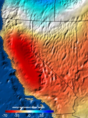 Areas in red are seriously short of water in this image from NASA. The colors represent the deficits (in millimeters per year) in total water shortage in western states from Sept. 2011 to Sept. 2014.