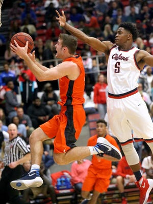 Blackman's Christian Dewitt (4) goes up for a basket as Oakland's Kaleb Oliver (5) defends Dewitt during the Oakland vs. Blackman boys game on Friday, Jan. 8, 2016, at Oakland. Going into the game both teams were undefeated for the season.